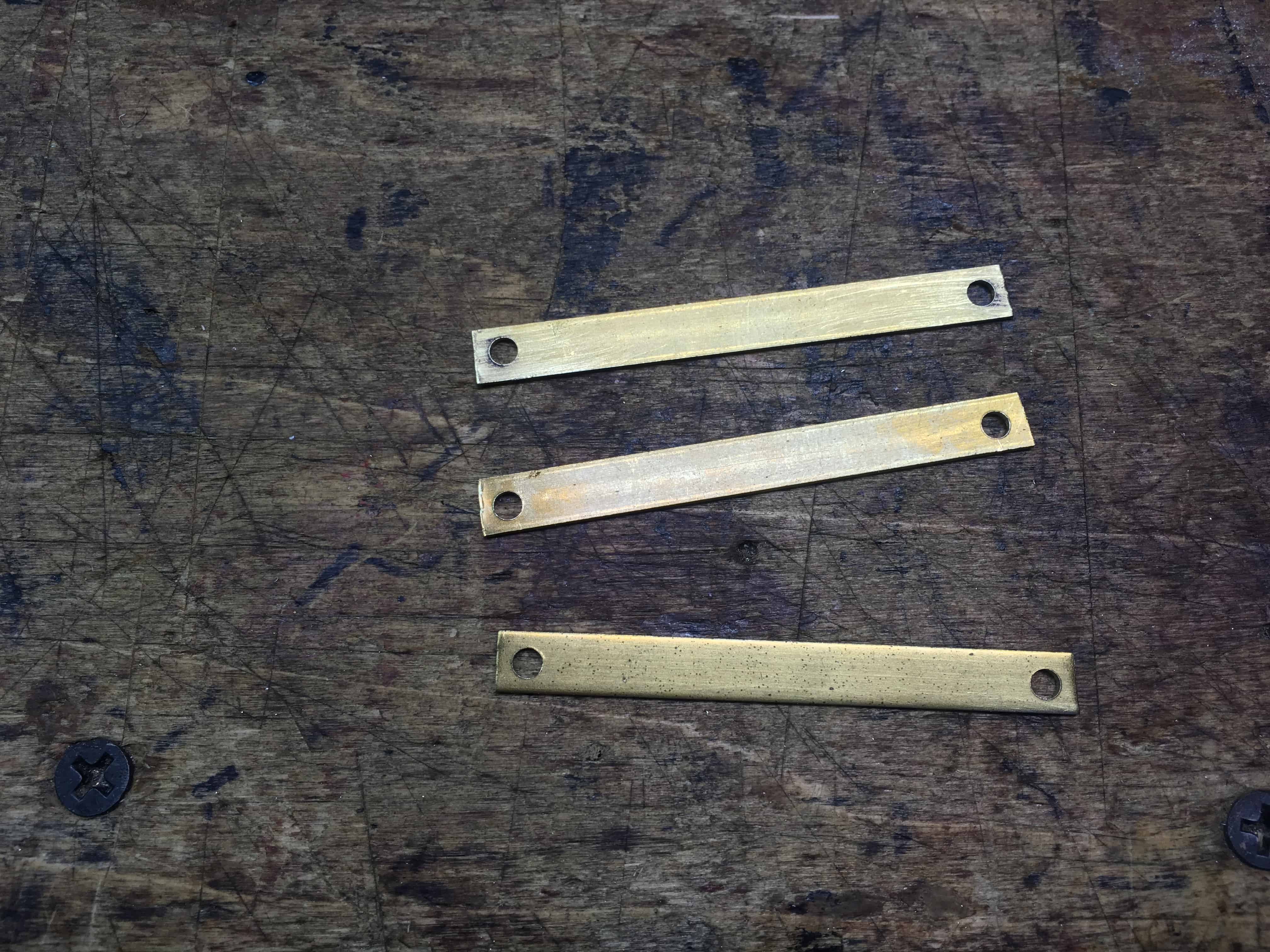 Brass strips cut and drilled
